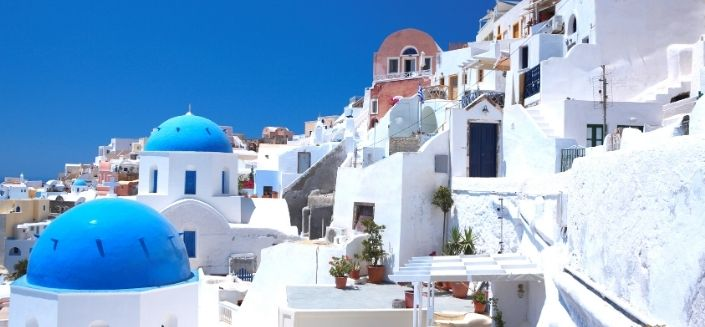 Houses with blue roofs on the Santorini island, Greece