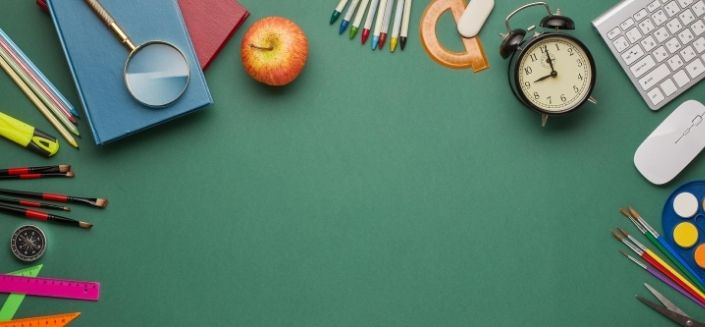 Various school-related items on a table to illustrate education